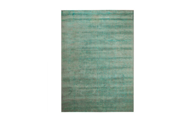Oceans is a beautiful area rug in a blue-green tone accented with brown and is hand-tufted inspired by arctic landscape