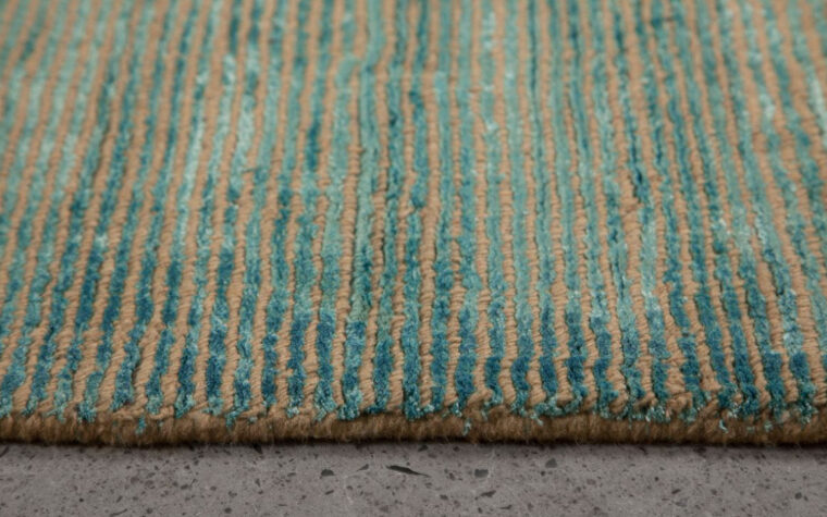 beautiful oceans area rug from renwill features blue and green tones accented by grey and looks great on concrete flooring!