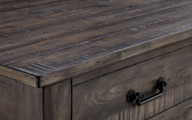 detailed photo featuring the rustic weathered charcoal finish on the Abington lift top coffee table