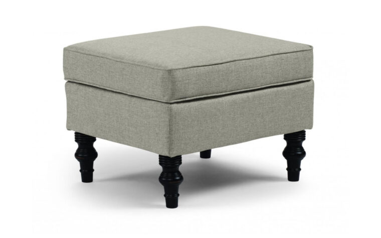 tyne ottoman is a traditional ottoman with paisley brown and whtie fabric and distressed pecan wood finish available in many fabrics