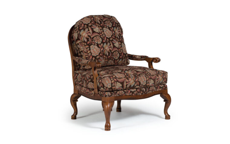 cogan accent chair is a victorian styled accent chair with distressed pecan finish and floral fabric