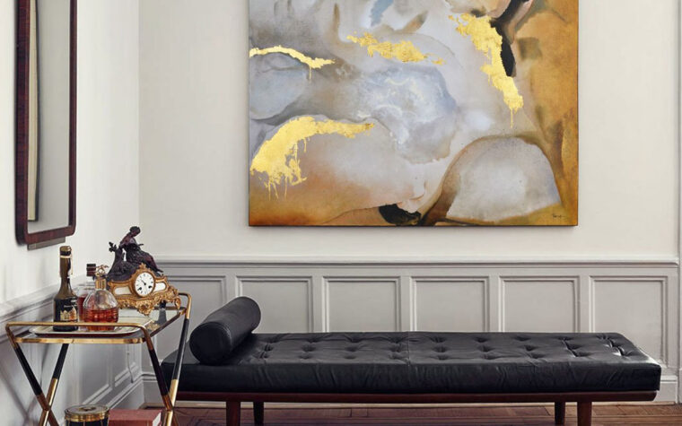 showcased in a modern room setting with black bench with tufting the new americana with gold leaf and black accents