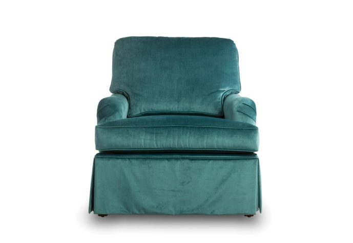 tesssa chair is skirted and shown in a blue velvet fabric