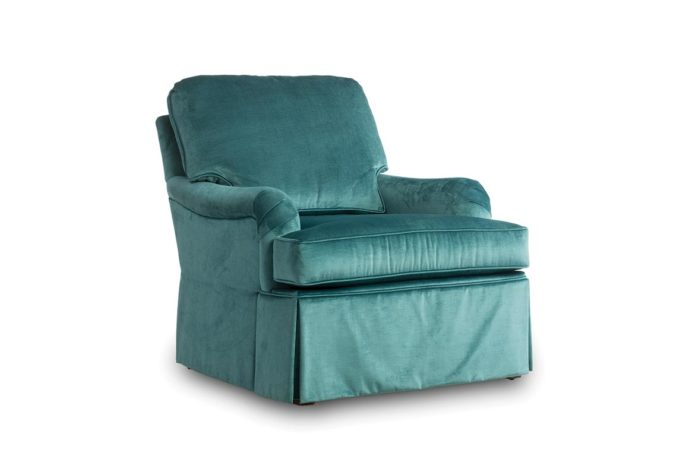 frong angl eof tesssa chair is skirted and shown in a blue velvet fabric