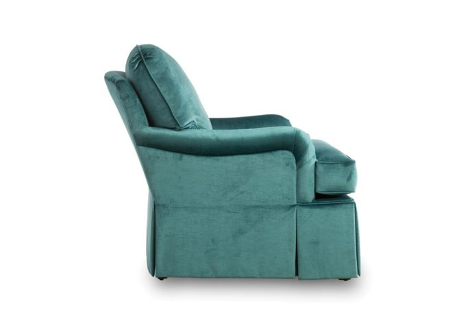 side angle of tesssa chair is skirted and shown in a blue velvet fabric