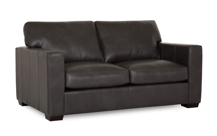 front angle of contemporary black leather loveseat with espresso wood finish