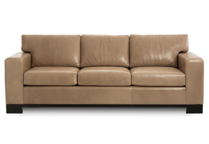 modern leather sofa from vogel in toronto, on showing a tan leather with espresso wood finish
