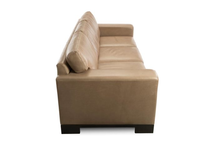 side view of modern leather sofa from vogel in toronto, on showing a tan leather with espresso wood finish