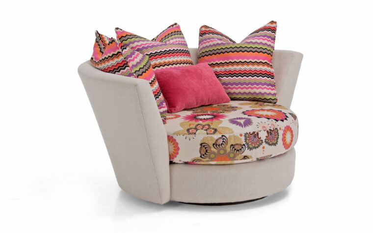 the 2224 swivel chair is a contemporary swivel chair that comes with multiple toss pillows