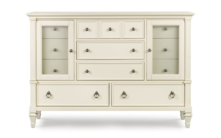 The Ashby Dresser features a Patina White finish with contrasting fired nickel hardwood and reeded glass.