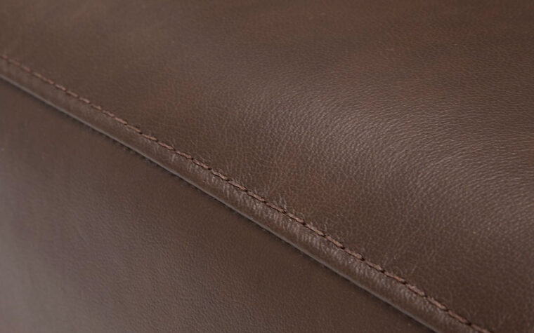 stitching detail of flex sofa is a contemporary sofa in brown leather with espresso wood finish