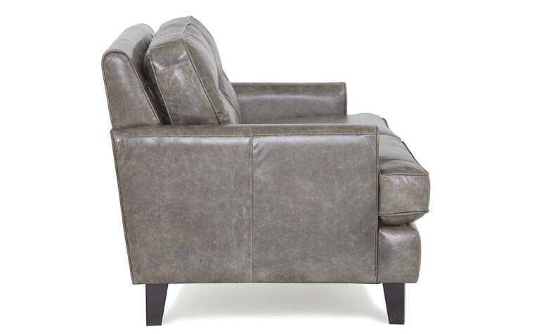 side view of barbara loveseat is a beautiful grey leather mid-century modern loveseat with button tufting