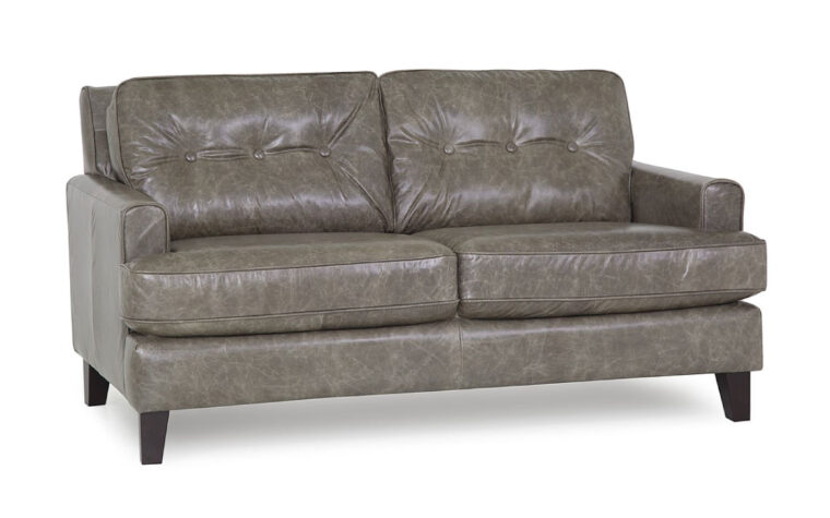 front angle of barbara loveseat is a beautiful grey leather mid-century modern loveseat with button tufting
