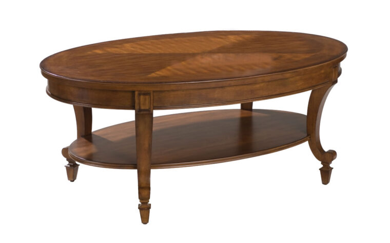 The Aidan Oval Cocktail Table is constructed from cherry veneer and hardwood solids and has a cinnamon finish.