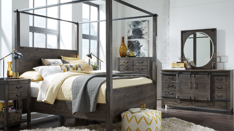 The Abington Poster Bed has a transitional design and finished in a weather charcoal finish
