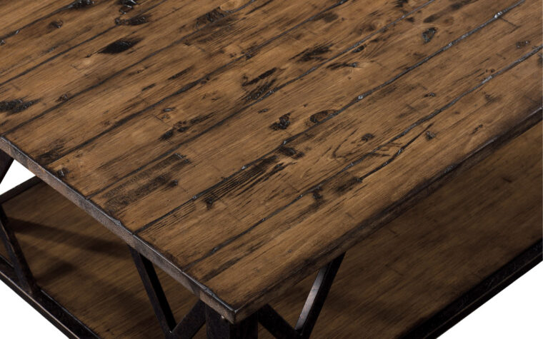 The Fleming Cocktail Table by Magnussen is crafted from pine veneer and has a rustic pine finish.