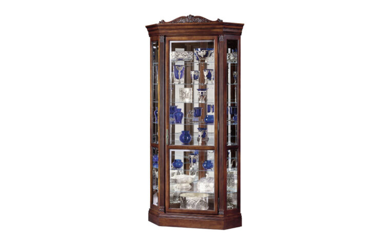 embassy ii curio cabinet is a traditional curio cabinet in a lightly distressed finish featuring carved details in cherry wood