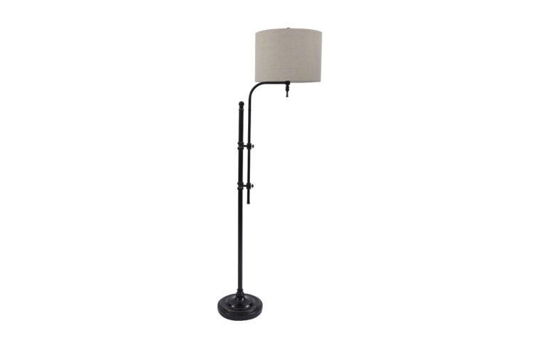 industrial metal floor lamp with dark metal base and a light tan cover