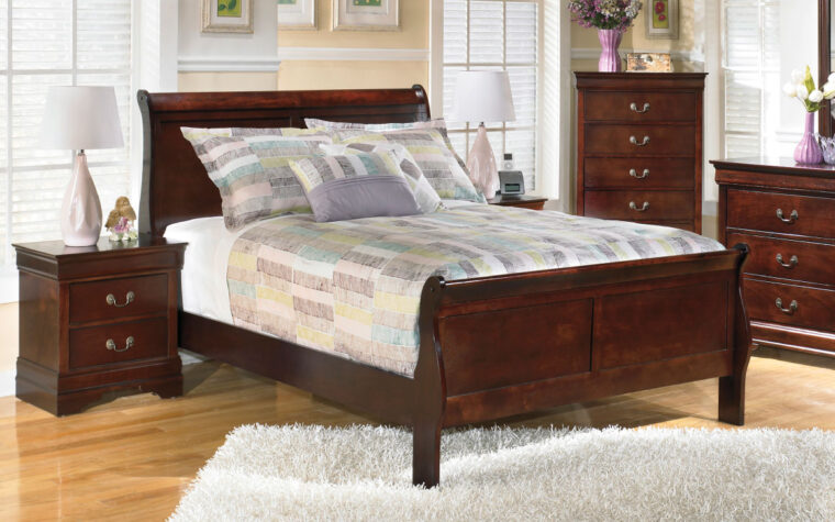 alisdair bed is a queen bed in a sleigh bed with a warm brown and red tone finish