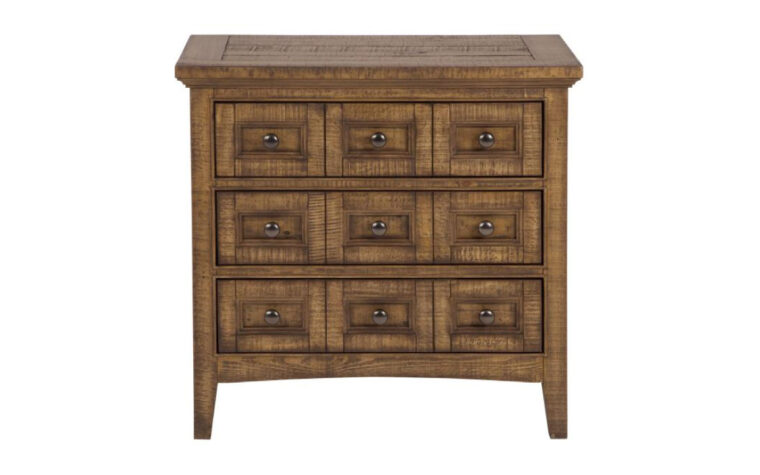 The Bay Creek Drawer Nightstand by Magnussen is constructed from pine veneer and pine solids and has a toasted nutmeg finish.