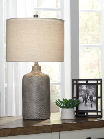 linus is a beautiful bedtime lamp with a ceramic base with a striking antique black effect