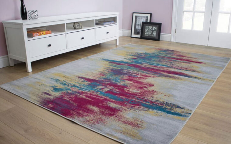 antika is a modern and contemporary area rug in grey, pink, turquoise, and yellow with an abstract pattern