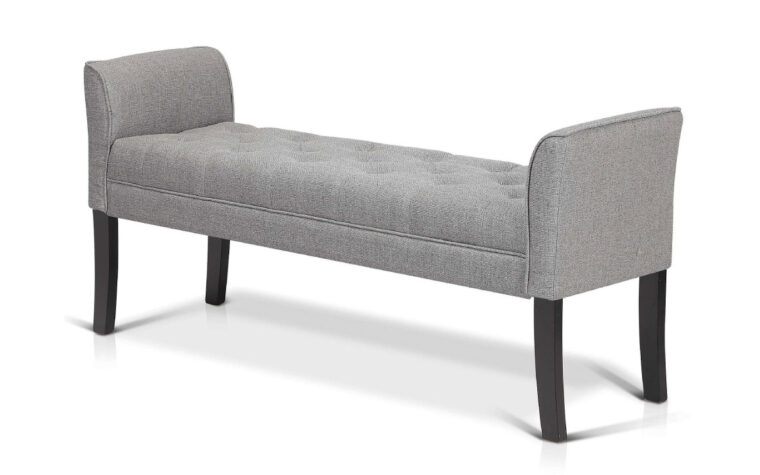norton bench is a contemporary bench with arms and tufting in a light grey fabric with dark black legs