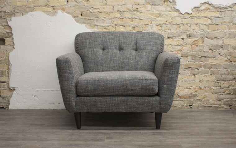 4740C Chair is a trendline chair in a mid-century modern design with back button tufting and wood legs