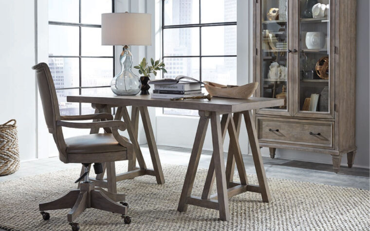 The Lancaster desk by Magnussen is constructed from pine veneer and has a dove tail grey finish