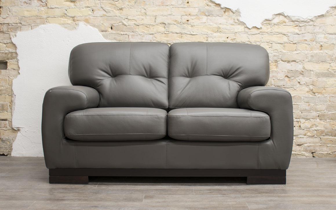 St Lawrence Loveseat upholstered in grey leather in Chervin Furniture & Design showroom (Elmira)