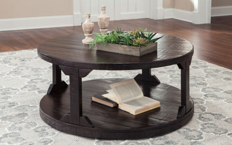 rogness cocktail table is a round cocktail table in a dark rum color with an open shelf - looks great in rustic home