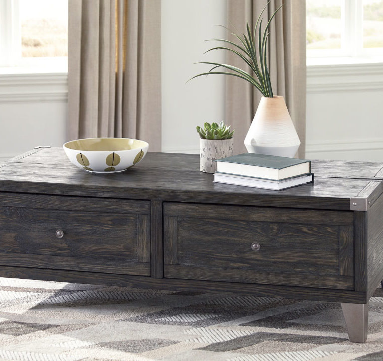 todoe cocktail table has a lift feature, grey distressed wood finish and two drawers with metal looking legs