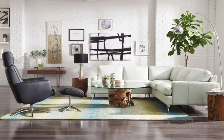 remington sectional is shown in a room setting with mid-century modern decor and a black chair