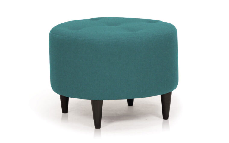 pally stool is a mid-century modern ottoman in a turquoise fabric with dark espresso legs and tufting on the seat