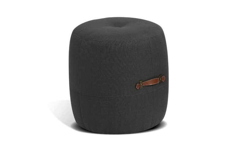 alto drum stool is a modern ottoman in a charcoal fabric with a leather brown strap or handle on it