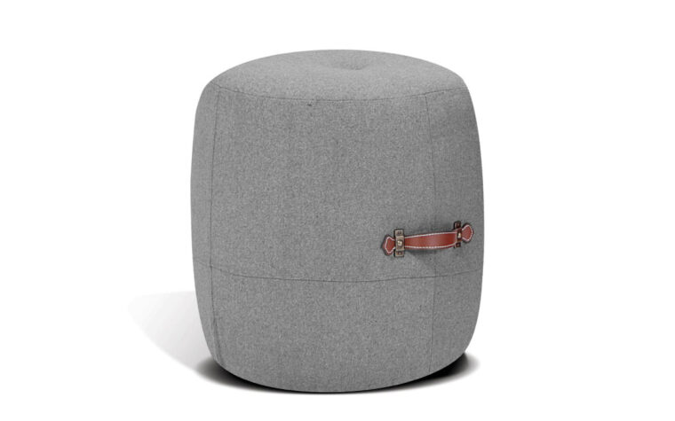 alto drum stool is a modern ottoman in a light grey fabric with two leather brown carrying straps