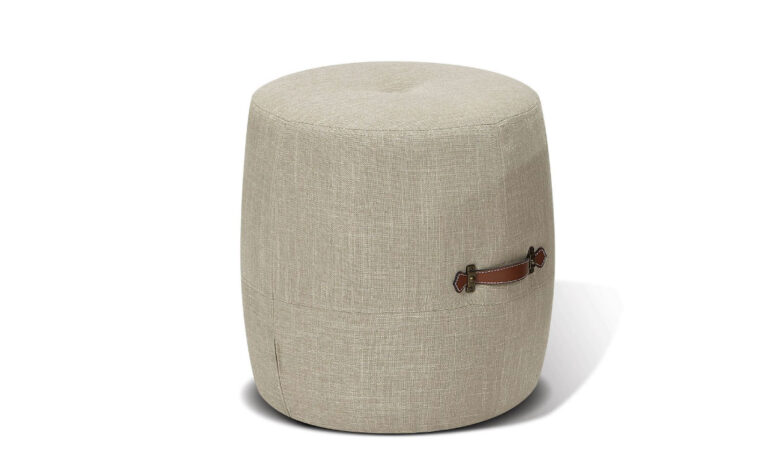 alto drum stool from korson is a contemporary stool design in a light grey fabric with 2 brown leather carrying handles