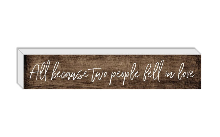 small wooden sign with the quote