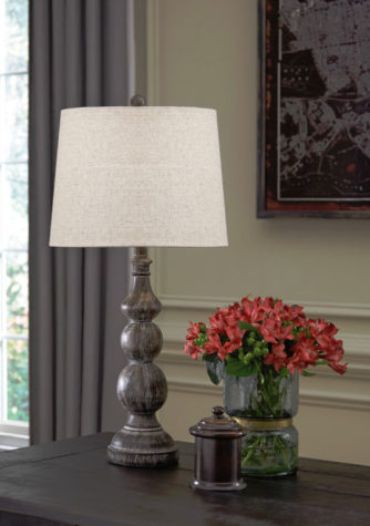 mair table lamp is a tradition table lamp with a white drum shade and a distressed base