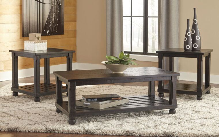 mallacar end table and cocktail set of three is in a distressed brown finish
