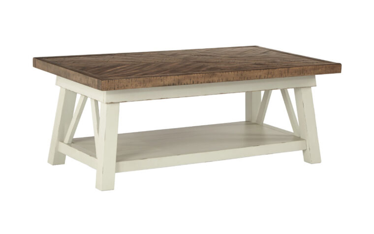 stownbranner cocktail table is a rustic cocktail table featuring a white distressed finish base accented with a grayish brown table top