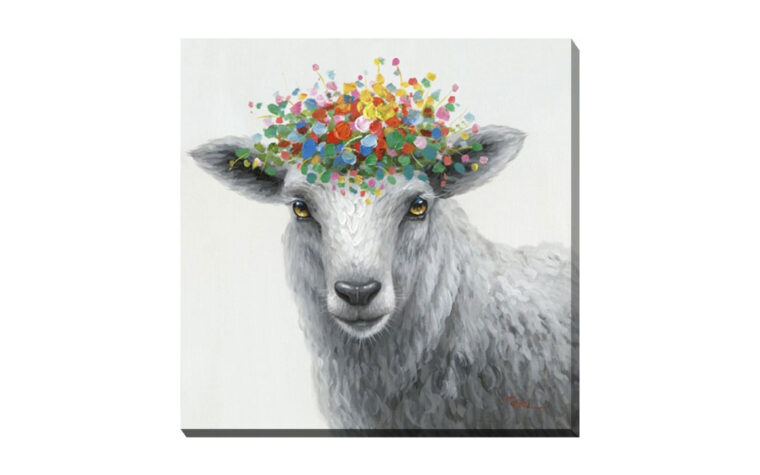cuddles crown is a sheep painted in black and white with a colorful crown of flowers on his head