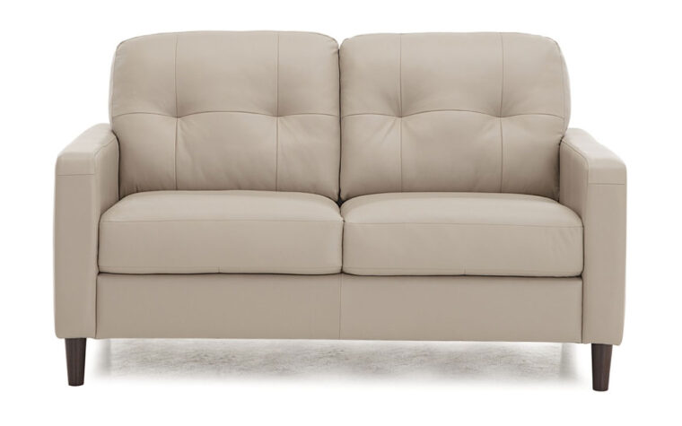 beach loveseat with tufting on back