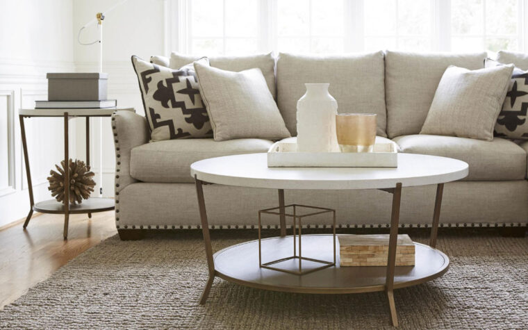 How to Mix-and-Match Styles At Home - airy cocktail table with heavy sofa