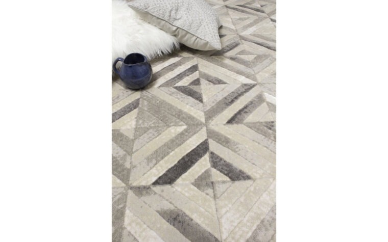 Alaska II Area Rug by Kalora - rug with varying degrees of grey overlapping in a geometric pattern of squares - close-up photo