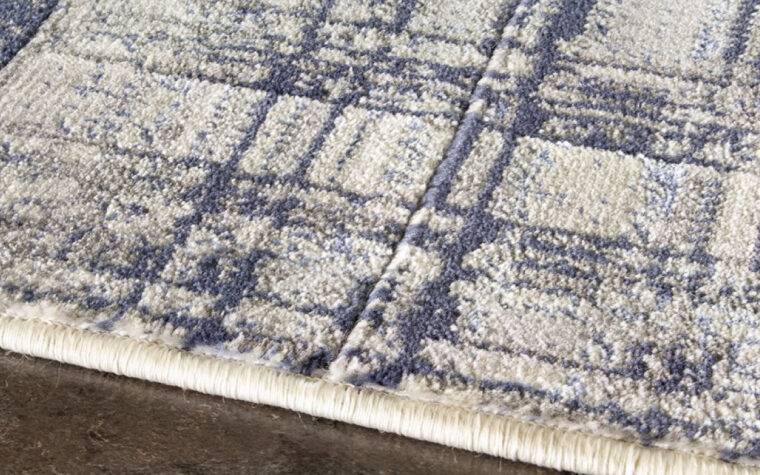 Alaska III Area Rug by Kalora - grey, blue, and cream cross-hatched, antiqued pattern on transitional area rug