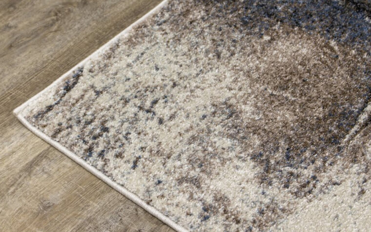 Breeze II Area Rug by Kalora - floor rug with marbled design of cream, black, brown, and teal blue (close-up)