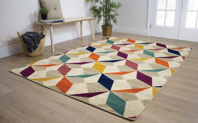 Brighton Area Rug by Kalora - multi-coloured geometric pattern on contemporary area rug - placed on light wood floor in bright room with wooden bench