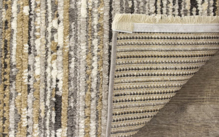 Calabar Area Rug by Kalora - thin sedimentary-style striped pattern of neutral brown and black tones (backing)
