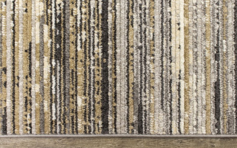 Calabar Area Rug by Kalora - thin sedimentary-style striped pattern of neutral brown and black tones (close-up)